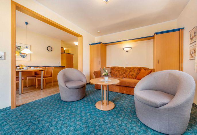 Beispiel: Wohnzimmer mit ausziehbarer Schlafcouch