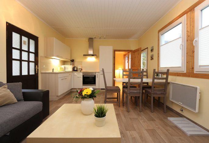 Fewo 4 - Bungalow Wohnzimmer mit offener Küche