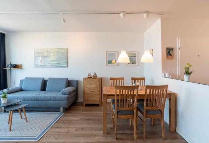 Ferienwohnung Pier 1167  Wohnzimmer mit Esstisch und Stühlen
