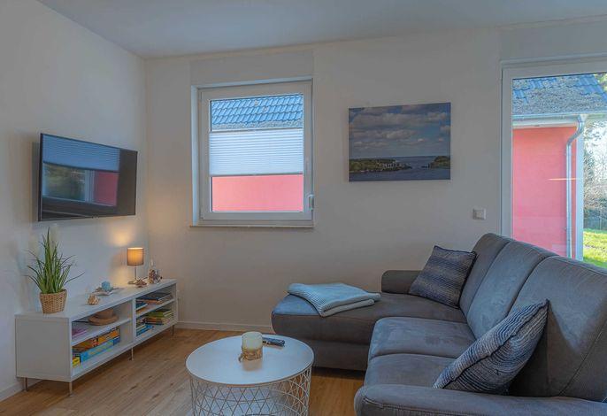 Wohnzimmer in der Ferienwohnung Merlin Nest