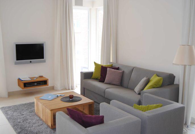 Wohnbereich mit TV und Musikanlage von Loewe