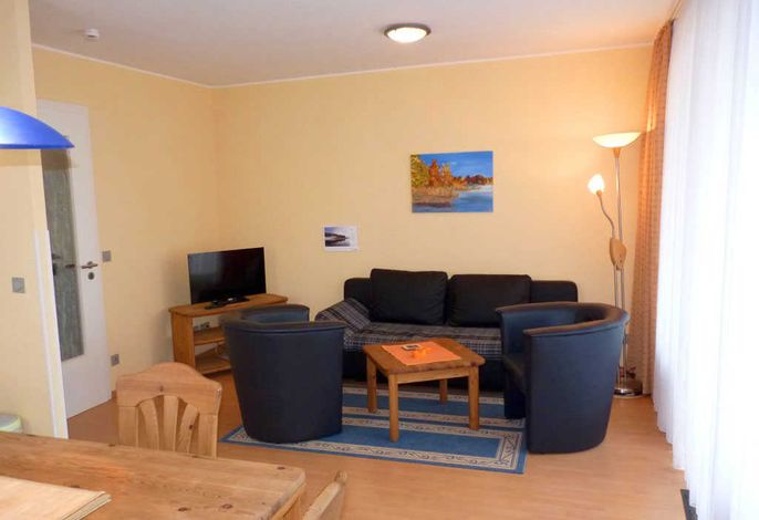 Wohnzimmer Appartementanlage Seeufer