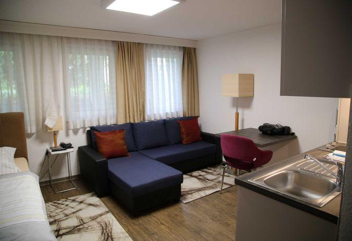 Wohn-/Schlafbereich Sofa
