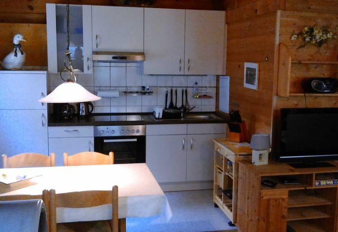 Blockhaus mit integrierter Einbauküche