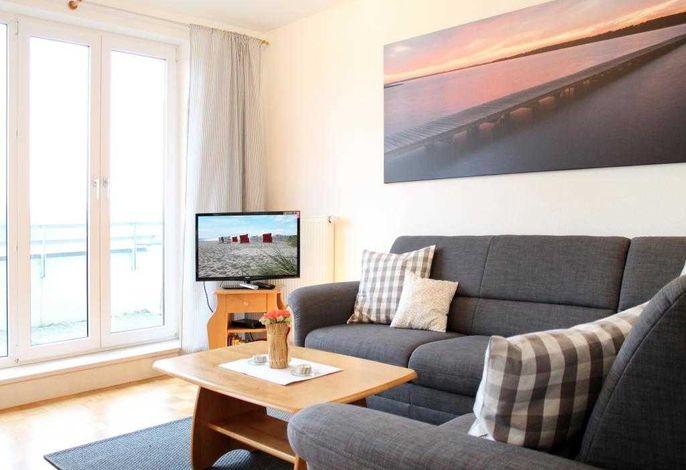 Seeschwalbe Whg.15 - Blick auf den Wohnbereich und den Fernseher