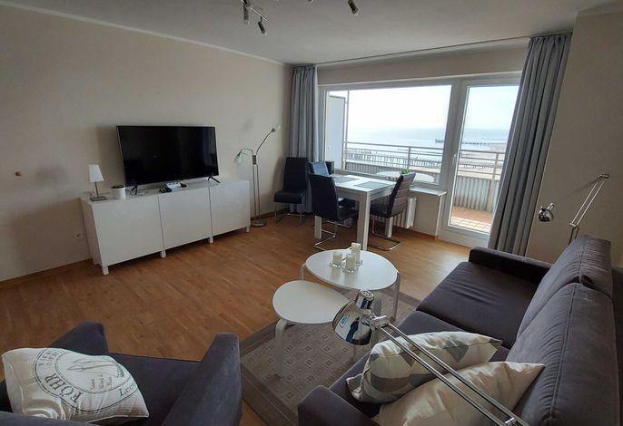 Wohnzimmer mit Eßplatz dirket am Panoramafenster