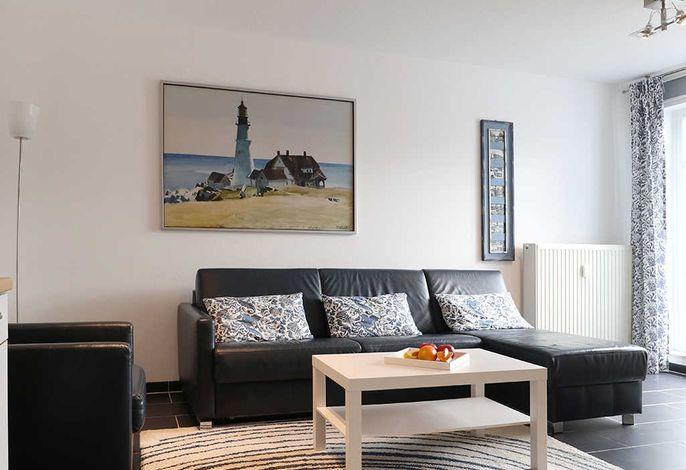 Residenz Haffblick App.12- Wohnbereich mit gemütlichem Sofa