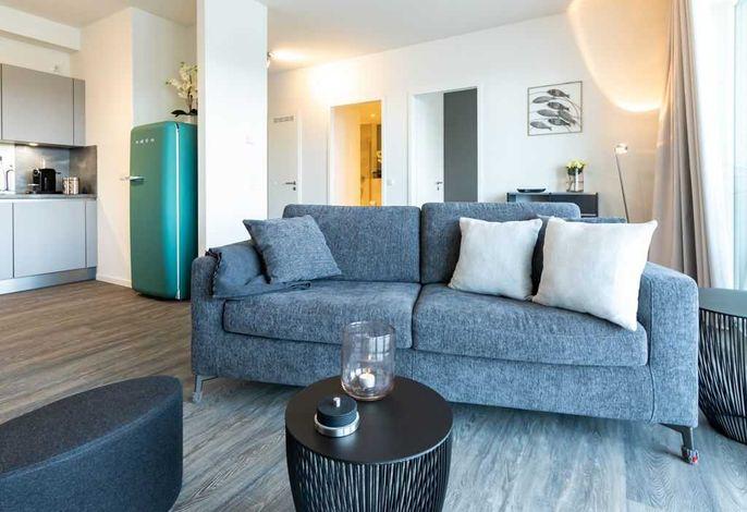Hafenspitze App.28- gemütliches Sofa im Wohnbereich