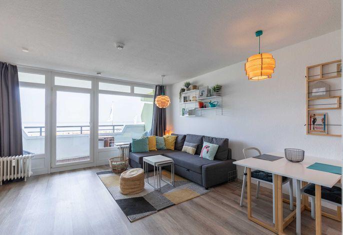 Wohnzimmer mit gemütlicher Sofa Ecke