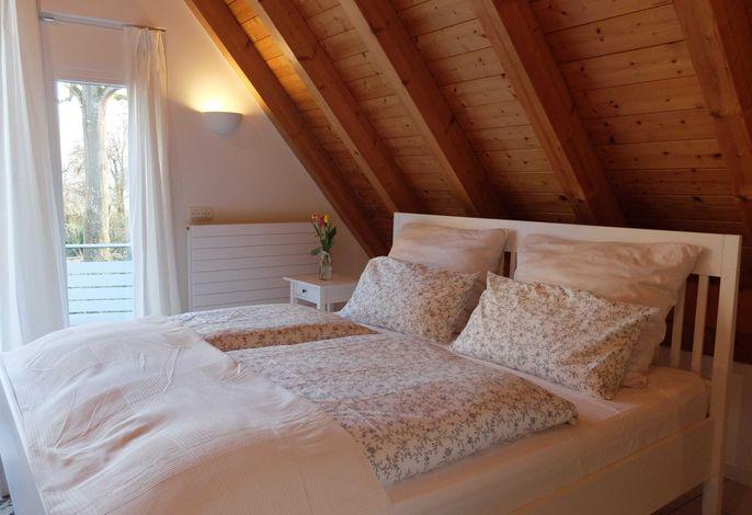 Schlossgartenhaus am Bodensee - Schlafbereich mit Blick auf das Schloss