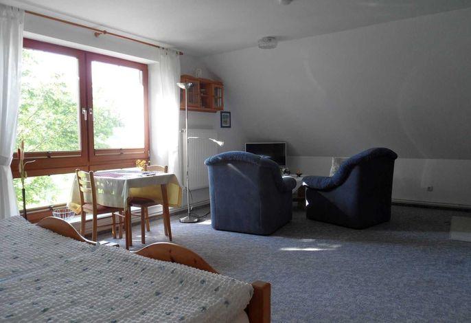 Sitzecke im 1 Raum-Appartement