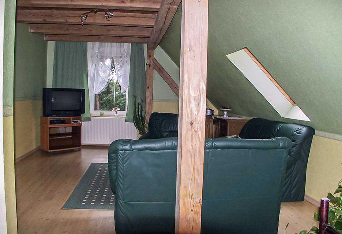 Wohnraum mit TV und Sitzecke