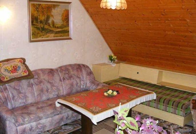 Wohnraum mit zusätzlichem Einzelbett