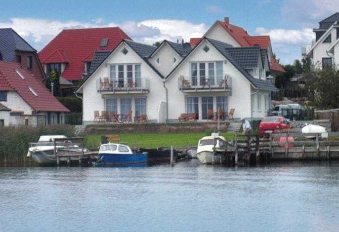 TOP-Ferienwohnungen direkt am Wasser mit Bootsanleger