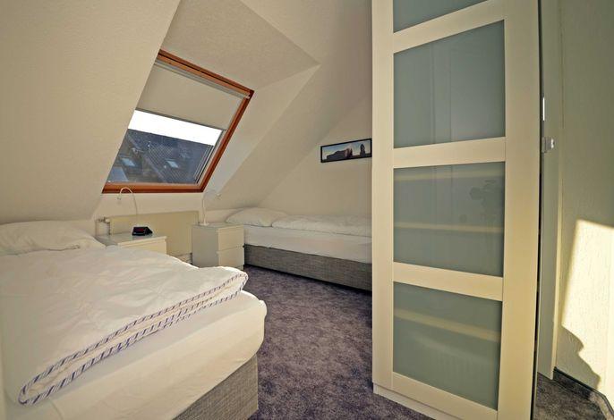 Schlafraum mit zwei Betten
