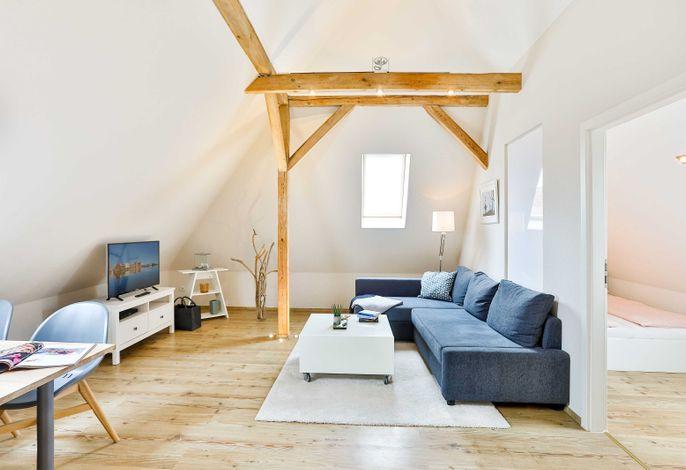 Wohnbereich mit TV mit Essbereich