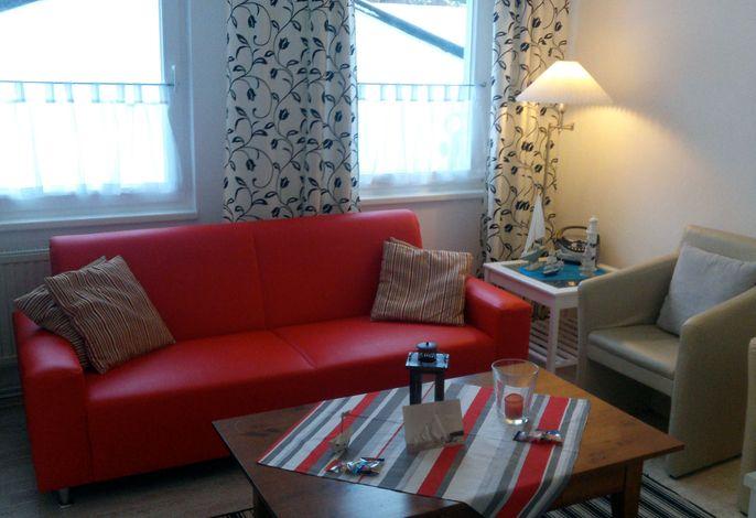 Wohnzimmer in der Ferienwohnung Kapitän im Haus Ostseeblick im Seebad Lohme auf der Insel Rügen