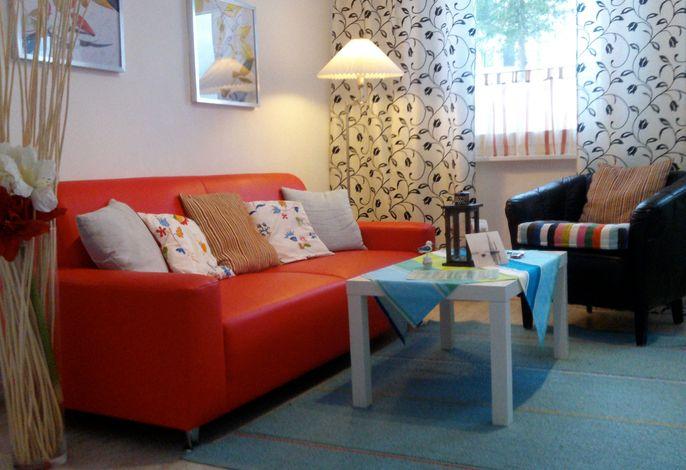 Wohnzimmer in der Ferienwohnung Seebär im Haus Ostseeblick in Lohme auf der Insel Rügen
