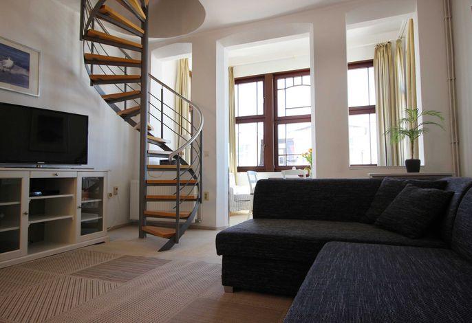 Wohnzimmer mit ausziehbarer Wohnlandschaft