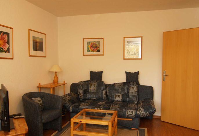 Das Wohnzimmer mit Sitzecke