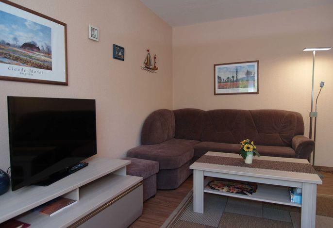 Das gemütliche Wohnzimmer mit Flachbild-TV