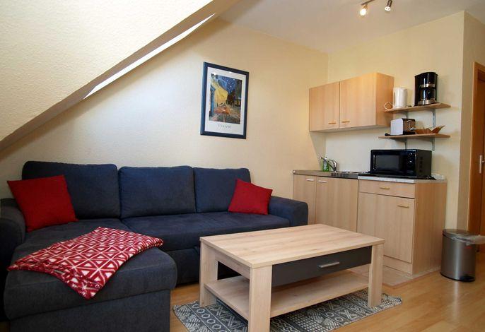 Der Wohnbereich mit Küchenzeile