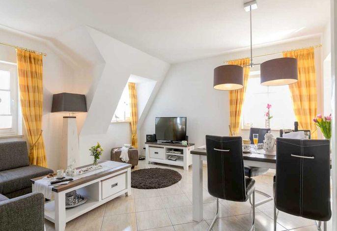 Wohnzimmer mit Flachbildfernseher (Kabel-TV)