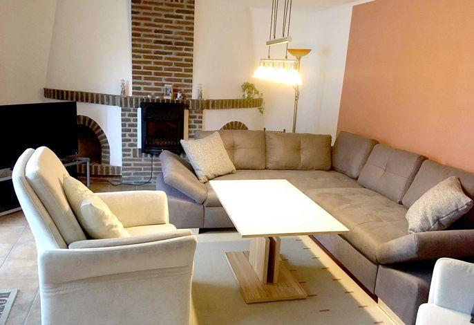Wohnzimmer mit Elektrokamin