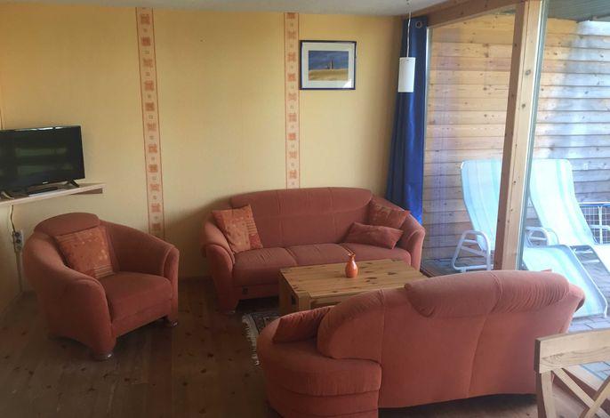 .Der Wohnbereich mit FlachTV