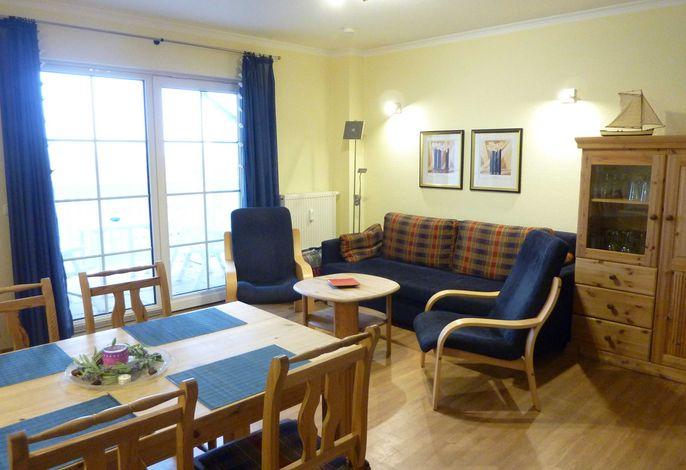 Der Wohnbereich mit Sitzgruppe für bis zu 5 Personen