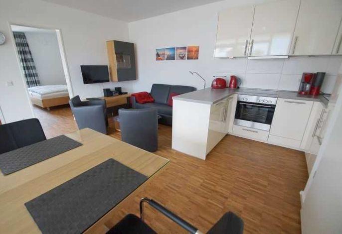 Blick auf den Küchenbereich im Wohnzimmer