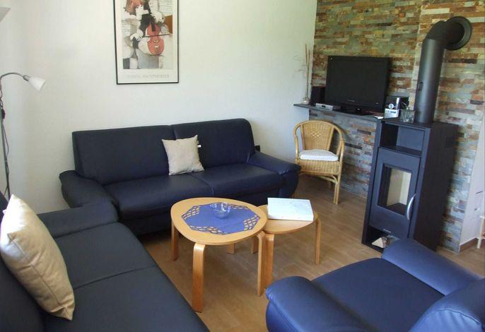 Wohnzimmer mit 3 Sofas