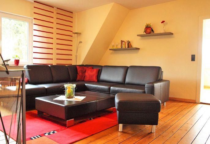 Modernes Wohnzimmer mit großzügiger Wohnlandschaft