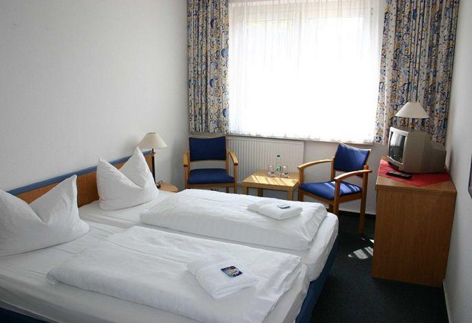 Schlafzimmer (getrennt stehende Betten)