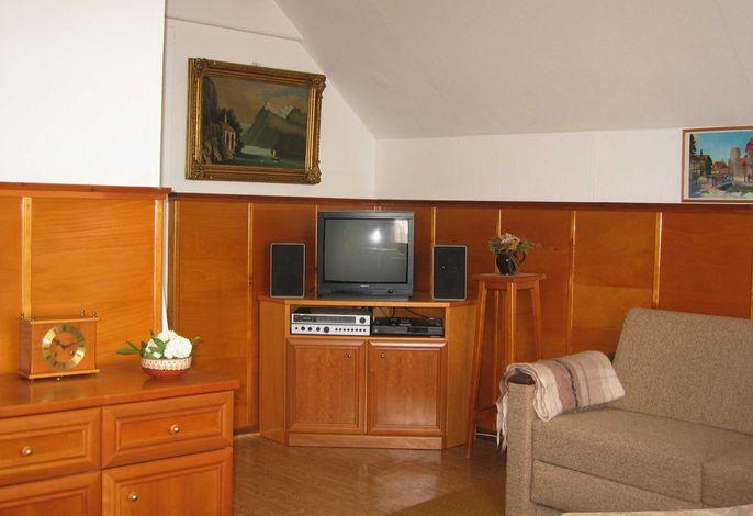 Wohnzimmer mit TV - Ecke