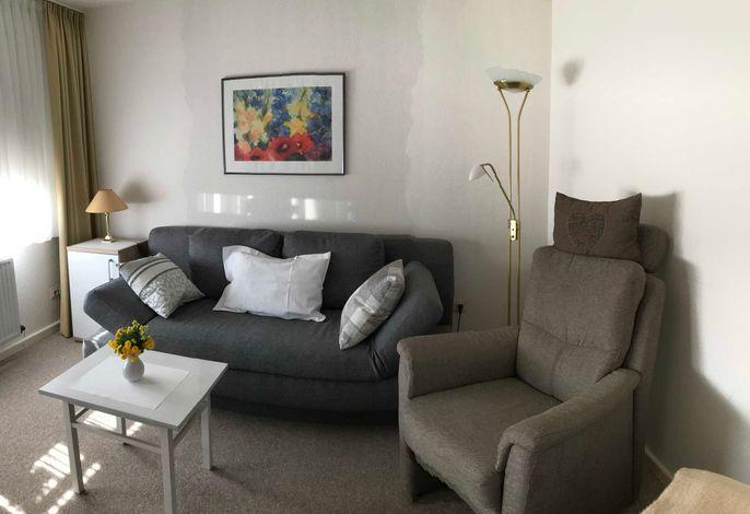 Wohnung 4 im Obergeschoss mit Sitzgruppe und 4. Schlafplatz