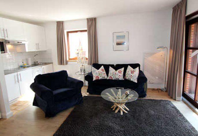 Ferienwohnung  B1 Wohnzimmer mit Südterrasse