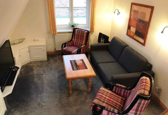 Das geräumige Wohnzimmer