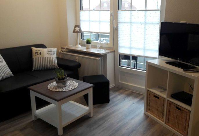 Wohnzimmer mit Flachbild