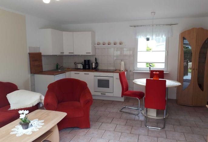 Wohn-/ Ess- und Küchenbereich