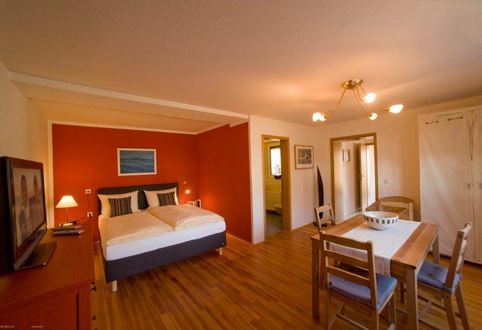 Wohnzimmer mit Schlafnische