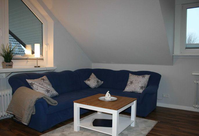 Legen Sie auf dem großen Sofa nach einem ereignisreichen und schönen Urlaubstag die Beine hoch.
