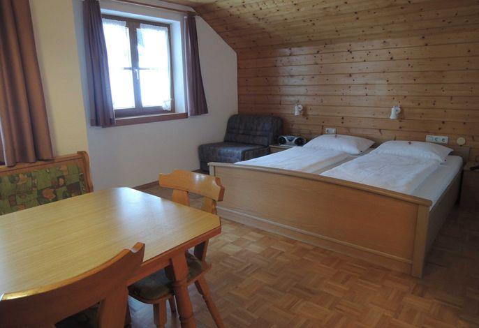 Essecke, Doppelbett und ausziehbares Sofa