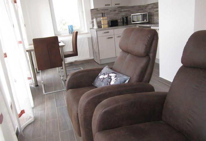 Wohnraum mit gemütlichen Sesseln
