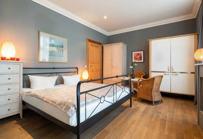 Wohn-/Schlafbereich mit Küchenzeile
