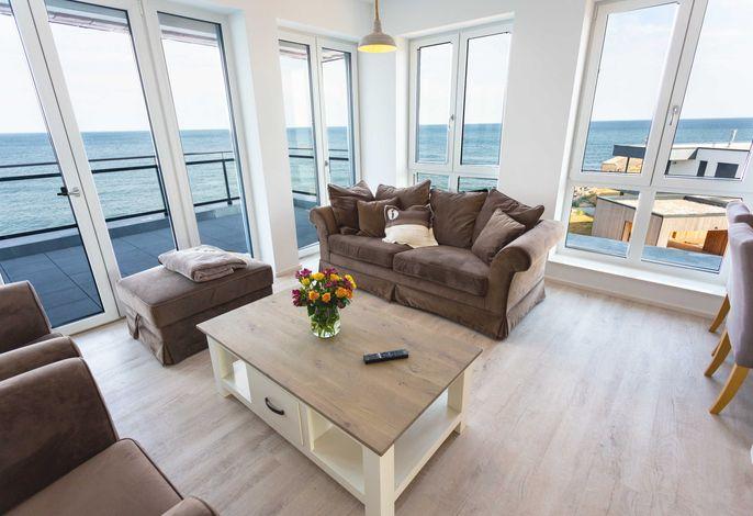 Ferienwohnung Dat Penthuus mit Meerblick - Wohnzimmer
