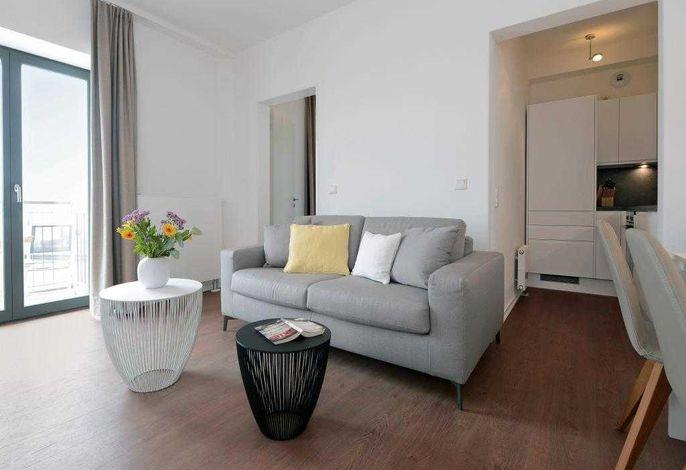 Ohlerich Speicher App.33- Wohnbereich mit gemütlichem Sofa