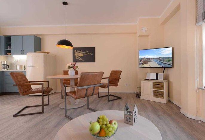 Ohlerich Speicher App. 11 - Blick vom Sofa auf den Essbereich und den TV