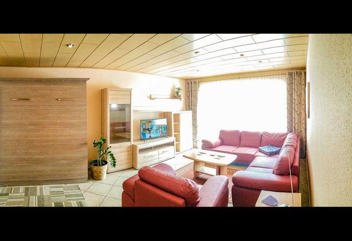 Wohnzimmer mit möglicher Aufbettung für 2 Pers mit Zugang zur Terrasse