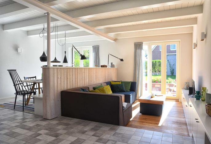 Der lichtdurchflutete Wohn-/Essbereich  ist das Herzstück des Hauses.